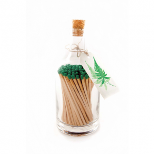 Green tip matches in a glass jar