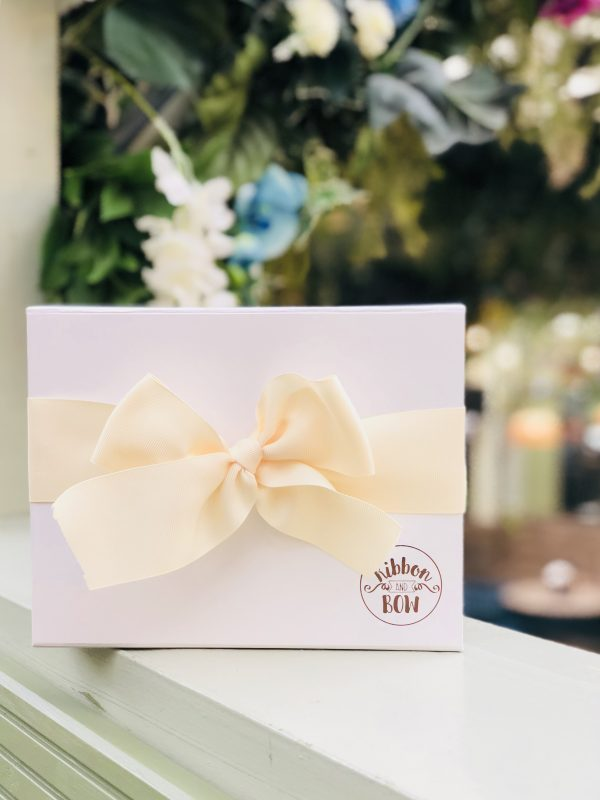 White gift box with a bow