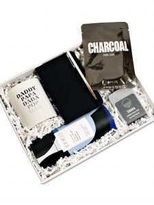 Gift box for guys with a mug for dad, charcoal soap, notebook and pen, face mask and luxury hot chocolate